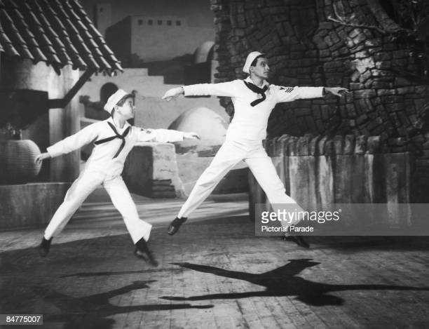 American singer and actor Gene Kelly with David Kasday in a scene from the MGM musical 'Invitation To The Dance' 1956 Kelly also directed and...
