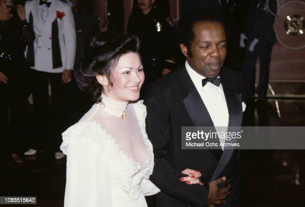American singer and actor Lou Rawls and an unspecified female companion attend the 40th Annual Golden Globe Awards, held at the Beverly Hilton Hotel...