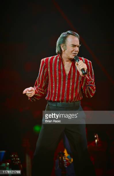 American singer and actor Neil Diamond performs live on stage at Wembley Arena in London on 25th May 1996