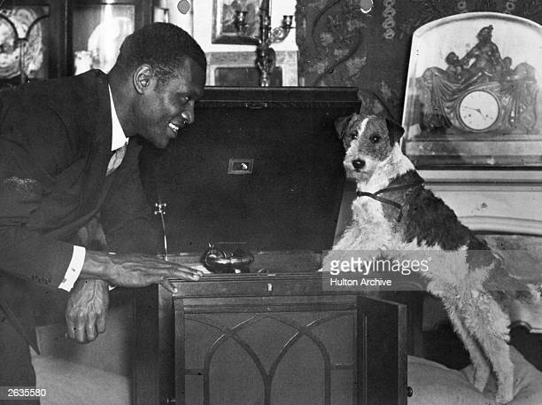 American singer and actor Paul Robeson and a dog