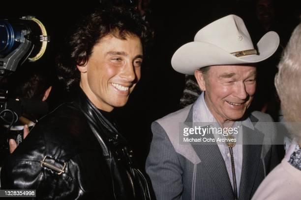 American singer and actor Roy Rogers with actor Matt Lattanzi , USA, circa 1992.