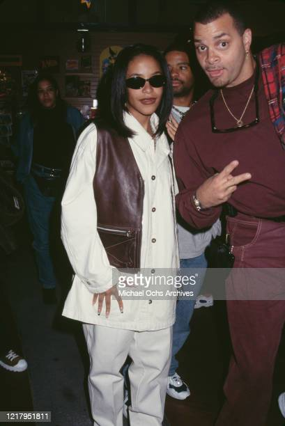 American singer and actress Aaliyah and American comedian Sinbad attend a press conference as Lifebeat's Counter AID announces its third annual...