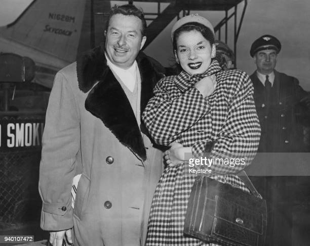 American singer and actress Abbe Lane and her future husband bandleader Xavier Cugat arrive at Newark Airport from Chicago 23rd January 1951 Cugat...