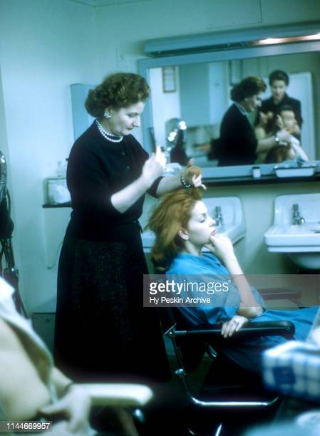 American singer and actress Abbe Lane and husband Xavier Cugat sit in the beauty shop as they get ready for their TV show on April 23 1957