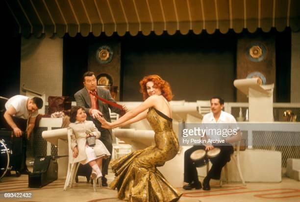 American singer and actress Abbe Lane dances to Latin and rumba music as her husband Xavier Cugat watches on April 23 1957