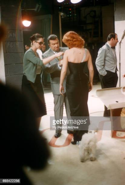 American singer and actress Abbe Lane gets ready to perform as her husband Xavier Cugat helps with her dress on April 23 1957