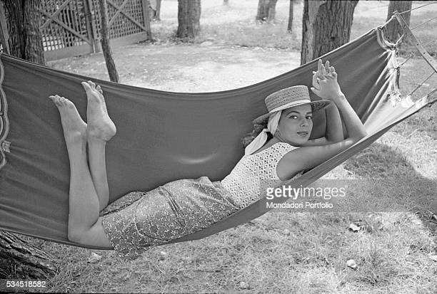 American singer and actress Abbe Lane lying on a hammock at the 19th Venice International Film Festival Venice August 1958
