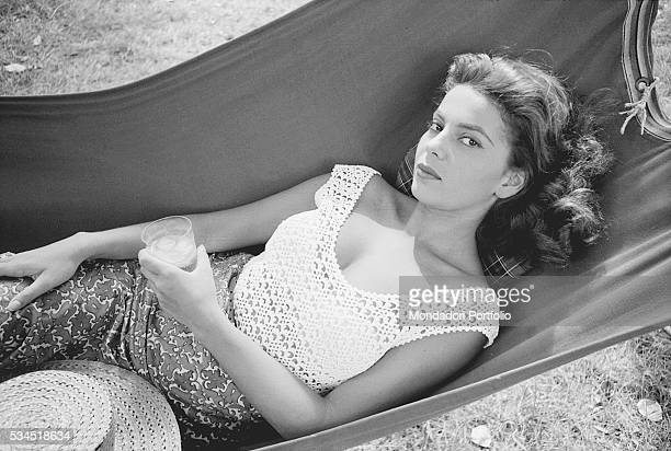 American singer and actress Abbe Lane lying on a hammock at the 19th Venice International Film Festival. Venice, August 1958