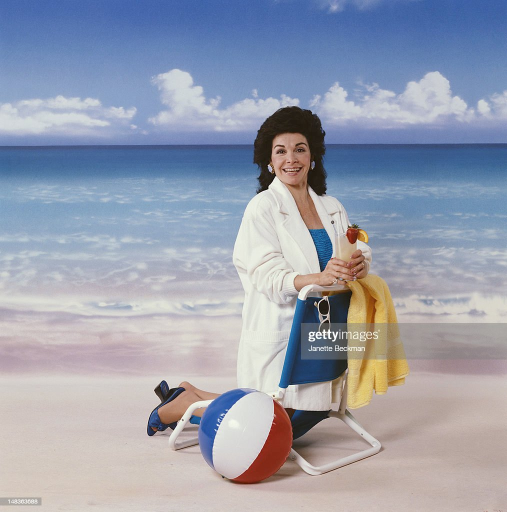 American singer and actress Annette Funicello poses on a beach set, New York City, 1998. She starred in several beach party films of the 1960s.