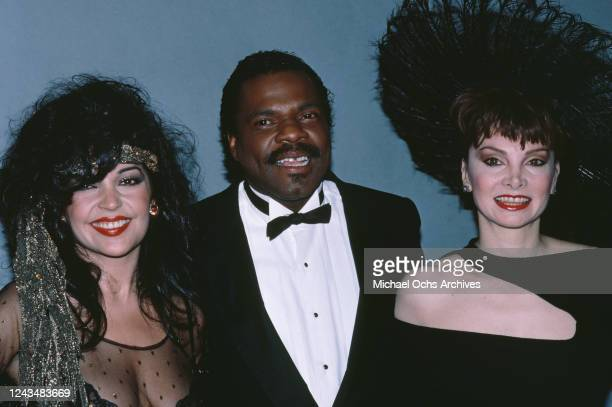 American singer and actress Apollonia Kotero American singer and keyboard player Billy Preston and American singer and dancer Toni Basil attend the...