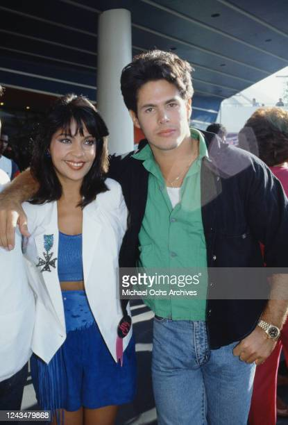 American singer and actress Apollonia Kotero and American actor and screenwriter Kevin Bernhardt attend the premiere of 'Captain EO' at the Epcot...