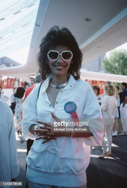 American singer and actress Apollonia Kotero attends the premiere of 'Captain EO' at the Epcot Center at Walt Disney World in Los Angeles California...