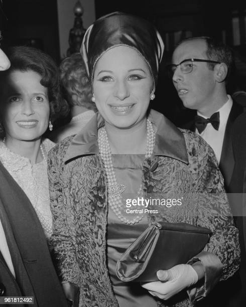 American singer and actress Barbra Streisand arrives at the Plaza Theatre in London for the gala premiere of the film 'Alfie' 24th March 1966 She is...