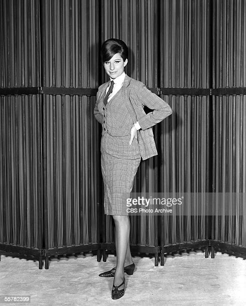 American singer and actress Barbra Streisand in a threepiece suit stands in front of a folding screen with her hands on her hips February 16 1965