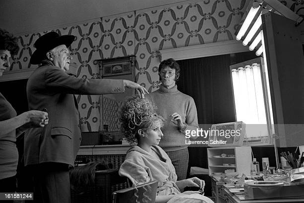 American singer and actress Barbra Streisand in front of her makeup mirror while British photographer and costume designer Cecil Beaton and American...