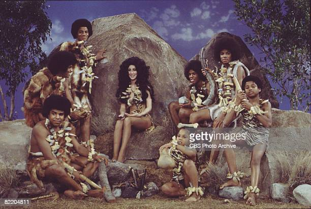 American singer and actress Cher and the popular musical group the Jackson 5 in prehistoric garb for a skit on the television variety show 'The Sonny...