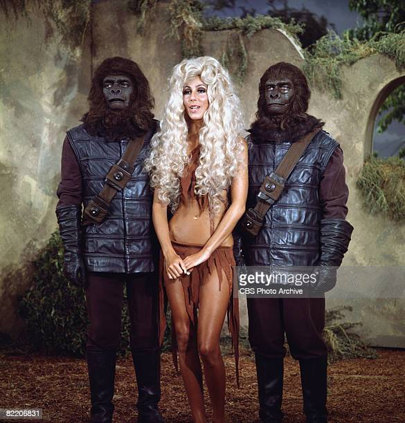 American singer and actress Cher appears with two actors in monkey costumes in skit that parodies the movie 'Planet of the Apes' on the television...