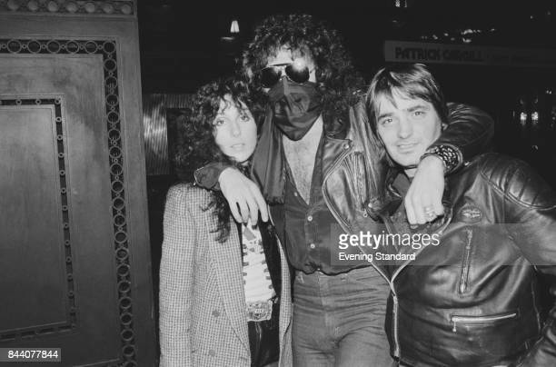 American singer and actress Cher with former boyfriend Israeli-American musician Gene Simmons of rock group Kiss, UK and an unknown friend, 11th...