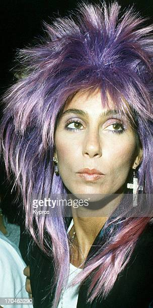 American singer and actress Cher with purple hair circa 1987