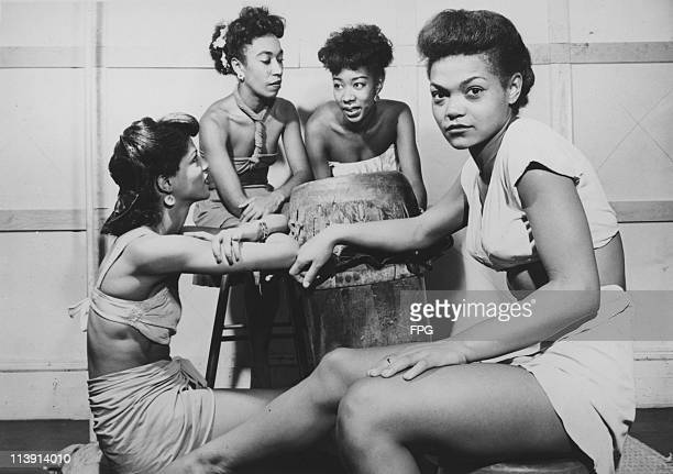 American singer and actress Eartha Kitt as a member of the Katherine Dunham Company circa 1945 With her are other members of the dance troupe Lawaune...