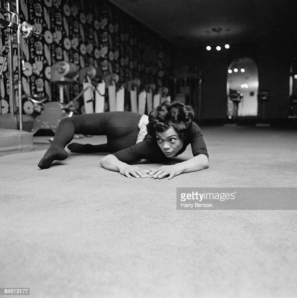 American singer and actress Eartha Kitt exercising at the Town and Country Health Salon in Knightsbridge, London, 1st April 1965.