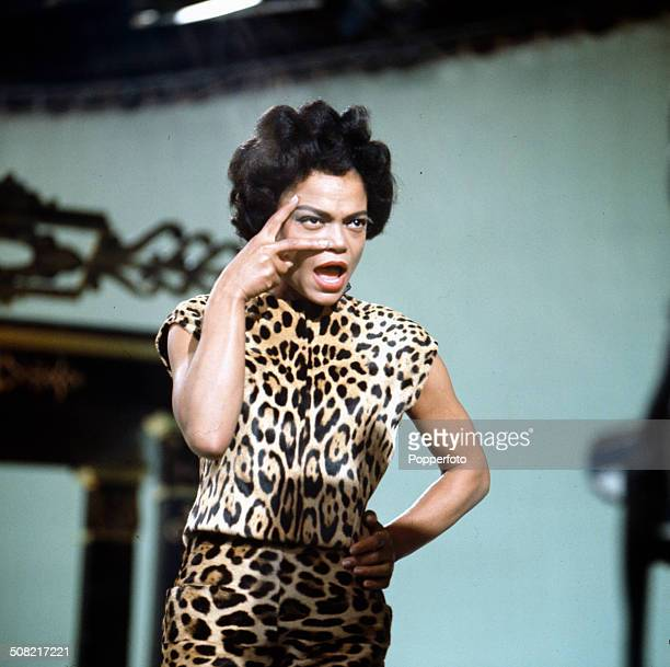 American singer and actress Eartha Kitt pictured wearing leopard print clothes performing on her television series 'The Eartha Kitt Show' in 1965