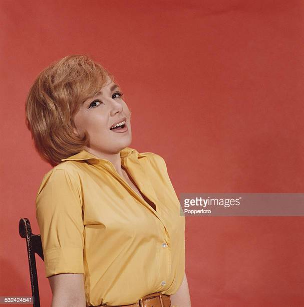 American singer and actress Edie Adams posed wearing a yelllow shirt in a photographic studio in 1962