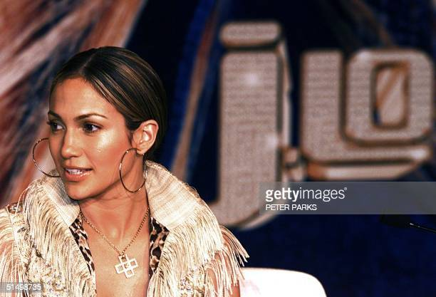 American singer and actress Jennifer Lopez listens to a question at a press conference 19 February 2001 in Hong Kong Lopez is here to promote her...