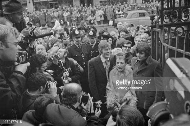 American singer and actress Judy Garland new 5th husband to be Mickey Deans and best man Johnnie Ray surrounded by crowds of onlookers and police...