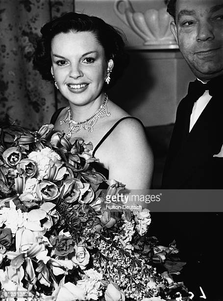American singer and actress Judy Garland receiving a bouquet, London, 1951. Garland; Judy: American entertainer, born in Grand Rapids, Minnesota....