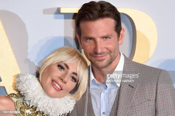 American singer and actress Lady Gaga and American actor and filmmaker Bradley Cooper pose on the red carpet upon arrival for the UK premiere of the...