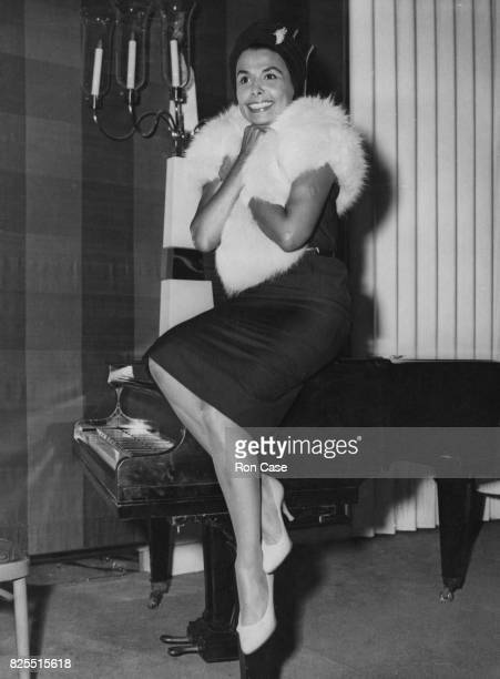 American singer and actress Lena Horne during a reception at the Savoy Hotel in London, where she is performing a four-week season of her cabaret...