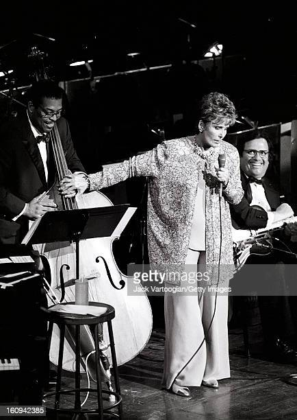 American singer and actress Lena Horne performs with Ben Brown on upright acoustic bass and the Ellington Orchestra at the JVC Jazz Festival concert...