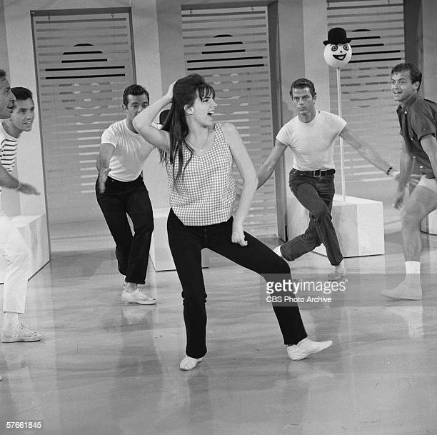 American singer and actress Liza Minnelli rehearses with dancers on the set of her mother's musical variety series 'The Judy Garland Show' July 15...