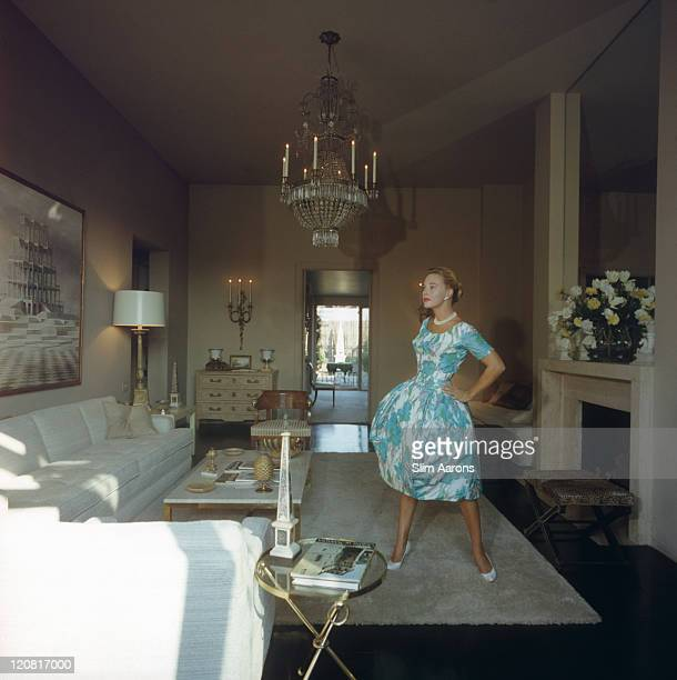 American singer and actress Lola Albright at Richard Lawson's penthouse in Los Angeles California 1960 She is wearing a puffskirted dinner dress of...