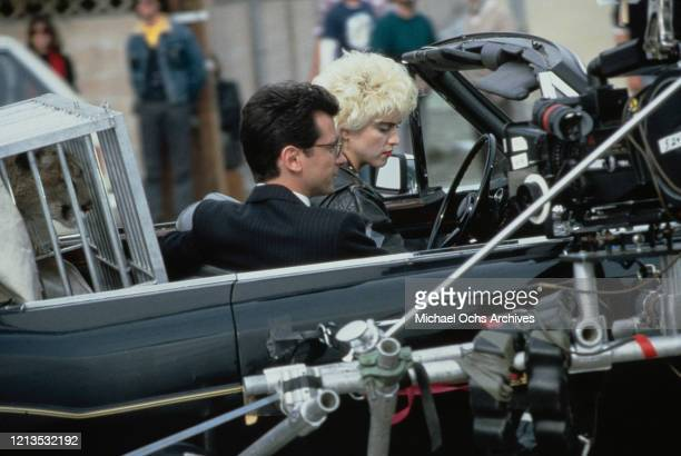 American singer and actress Madonna and her costar Griffin Dunne on the set of the film 'Slammer' later titled 'Who's That Girl' USA circa 1987