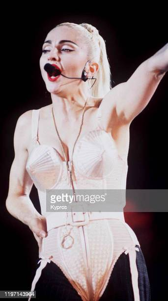 American singer and actress Madonna in concert wearing her iconic cone bra circa 1990