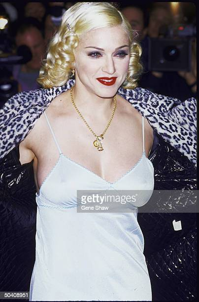American singer and actress Madonna in white slip dress 1995
