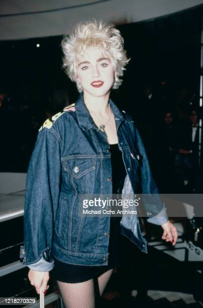 American singer and actress Madonna takes part in a celebrity fashion show at Barneys clothing store in New York City, 10th November 1986. Proceeds...