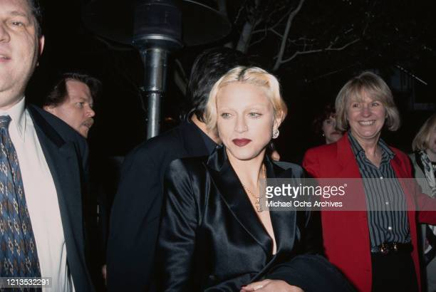 American singer and actress Madonna with producer Harvey Weinstein at the premiere of the film 'PretaPorter' in Los Angeles California 20th December...