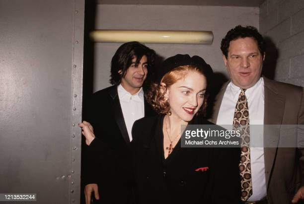 American singer and actress Madonna with producer Harvey Weinstein and director Alek Keshishian at the premiere of the film 'Hear My Song' in Los...