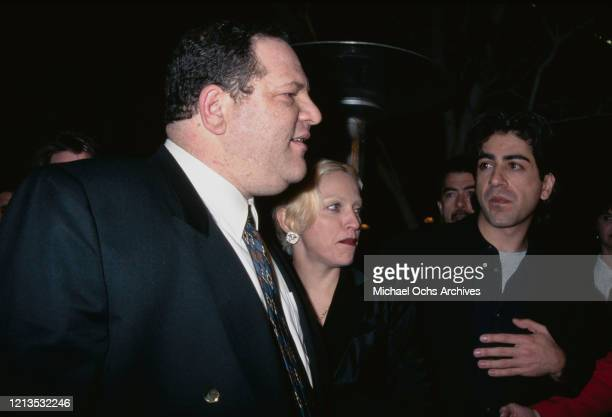 American singer and actress Madonna with producer Harvey Weinstein and director Alek Keshishian at the premiere of the film 'PretaPorter' in Los...