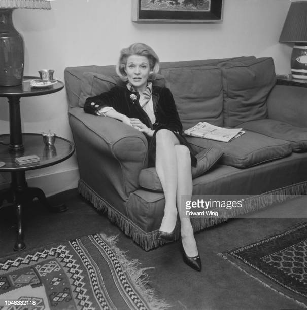 American singer and actress Marti Stevens pictured seated on a sofa in London on 30th April 1963