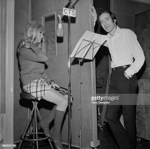 American singer and actress Nancy Sinatra and English composer John Barry at the CTS Studios recording James Bond them song 'You Only Live Twice',...