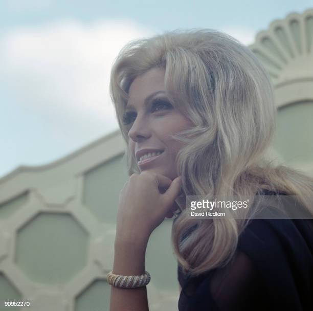 American singer and actress Nancy Sinatra posed at a hotel roof garden in London on 8th May 1967.