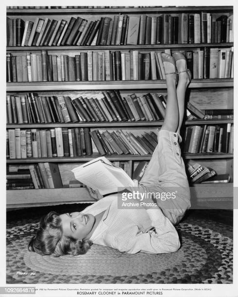 American singer and actress Rosemary Clooney reading in her home in Brentwood Los Angeles 1952 She is in the middle of filming 'The Stars are...