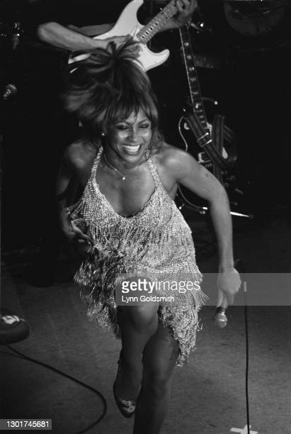 American singer and actress Tina Turner, wearing a fringed dress, performing live on stage at the Ritz Carlton Hotel in New York City, New York, May...