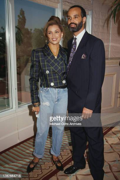 American singer and actress Vanessa Williams, wearing a green and blue check jacket, and her husband Ramon Hervey II attend the Soul Train Awards...