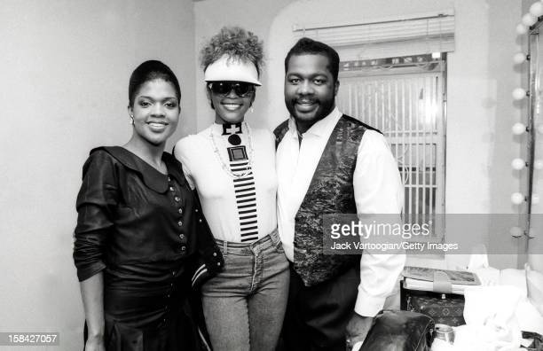 American singer and actress Whitney Houston poses with sibling Gospel singers Cece and Be Be Winans backstage after a Winans concert at Harlem's...