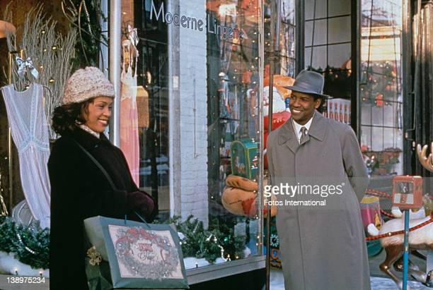 American singer and actress Whitney Houston stars with Denzel Washington in the film 'The Preacher's Wife' 1996